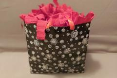 Love decorative bags? Scrunchies add a pop of gorgeous color to your gifts. This little ensemble is a black and red classic.