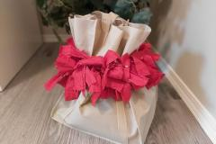 A stunning red Gift Bag Scrunchie is a perfect pick for anyone, any occasion. This one is cinched over a cloth bag.