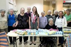 There are knitting groups throughout Kelowna who meet up once a week and knit warm blankets, scarves, hats, and mittens for us to redistribute to families who need them.